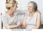 stock-photo-beautiful-mature-woman-holding-hands-her-senior-mother-147404285